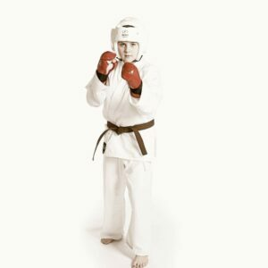 Youth karate student with sparring gear